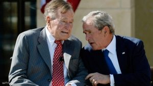 DALLAS, TX - APRIL 25:  Former President George W. Bush (R) talks to his father President George H.W. Bush during the opening ceremony of the George W. Bush Presidential Center April 25, 2013 in Dallas, Texas. The Bush library, which is located on the campus of Southern Methodist University, with more than 70 million pages of paper records, 43,000 artifacts, 200 million emails and four million digital photographs, will be opened to the public on May 1, 2013. The library is the 13th presidential library in the National Archives and Records Administration system.  (Photo by Kevork Djansezian/Getty Images)